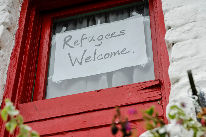 Refugees welcome written on a piece of paper in a window
