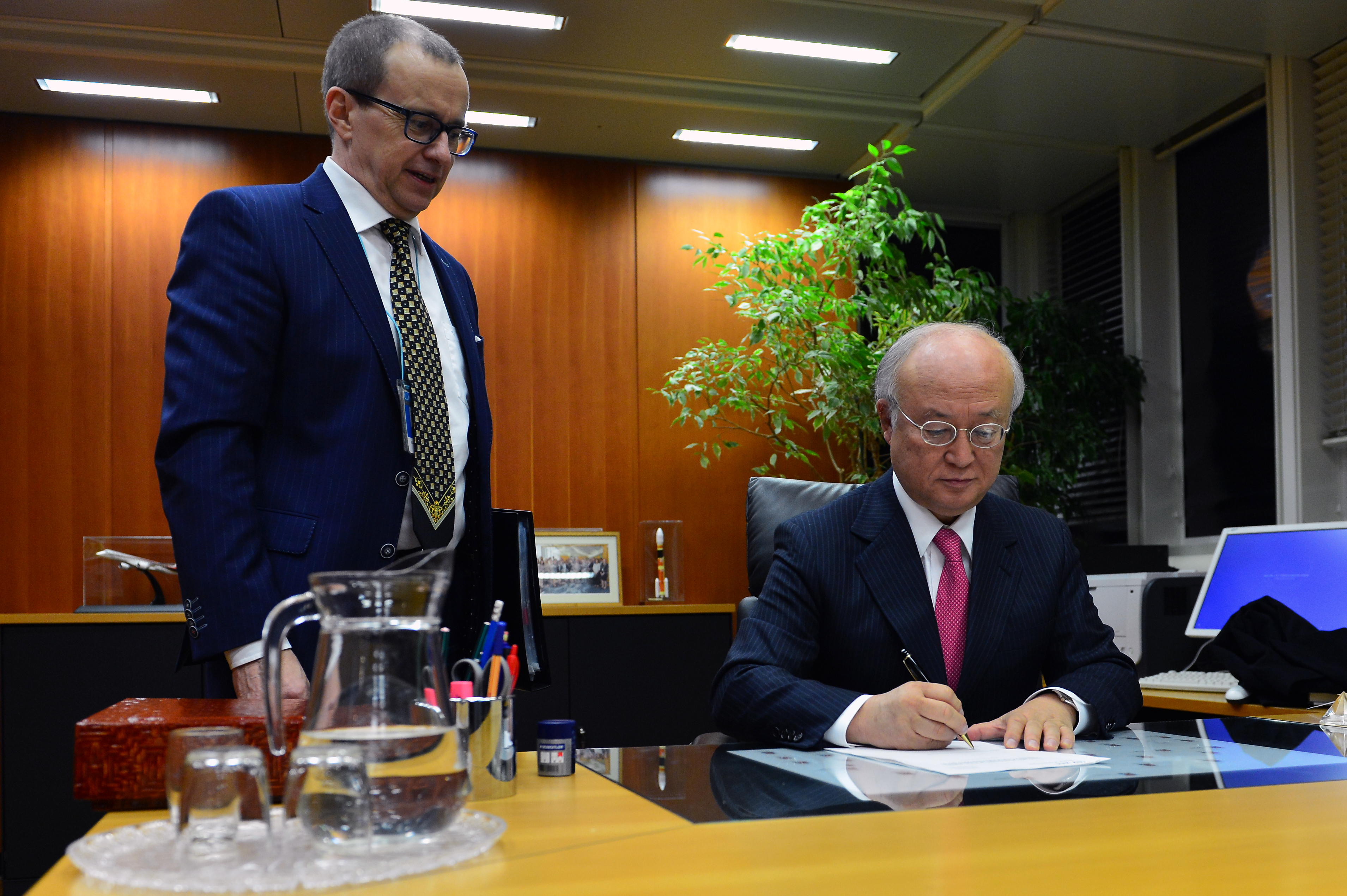 IAEA Director Yukia Amano clears a report paving the way for full implementation of the JCPOA.