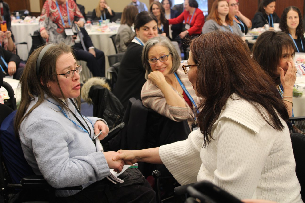 Senator Tammy Duckworth speaks with a participant at JDAD 2018
