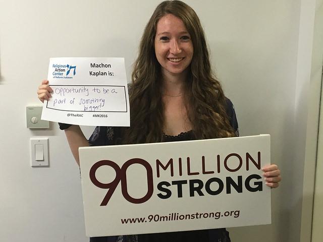 Rachel Kahn holding sign; 90 million strong to abolish the death penalty