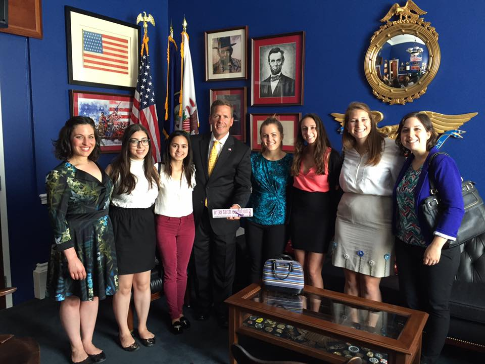 Amy Singer, interfaith coalition members meet with Rep. Dold