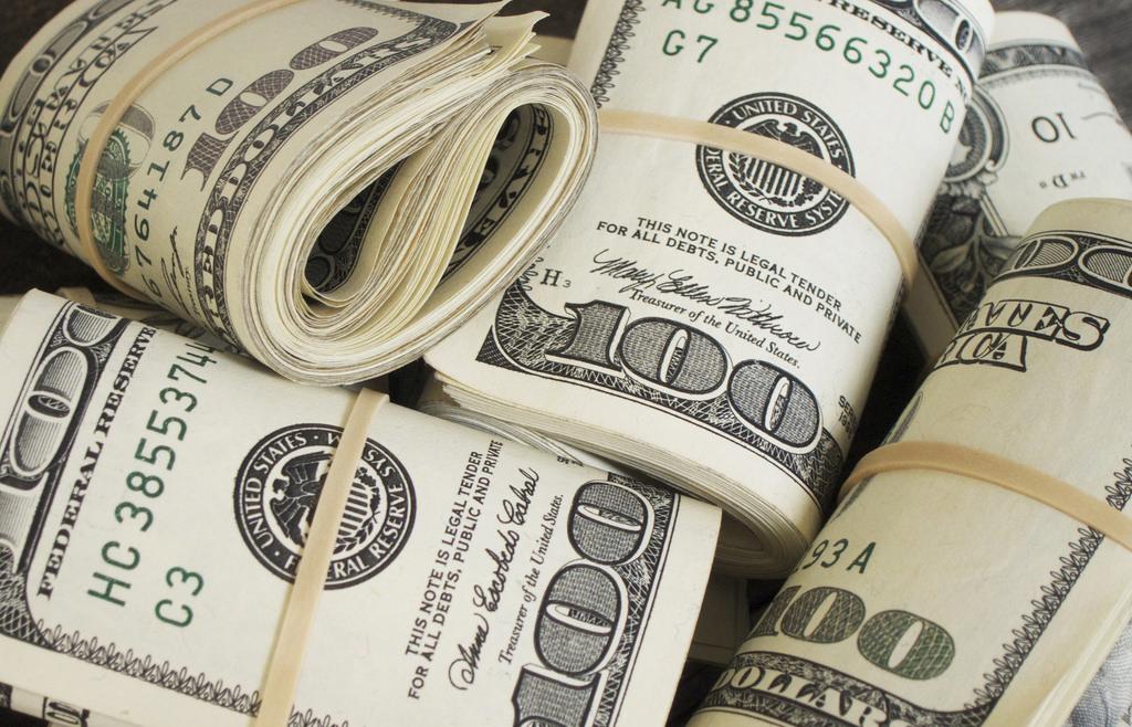 rolled up 100 dollar bills