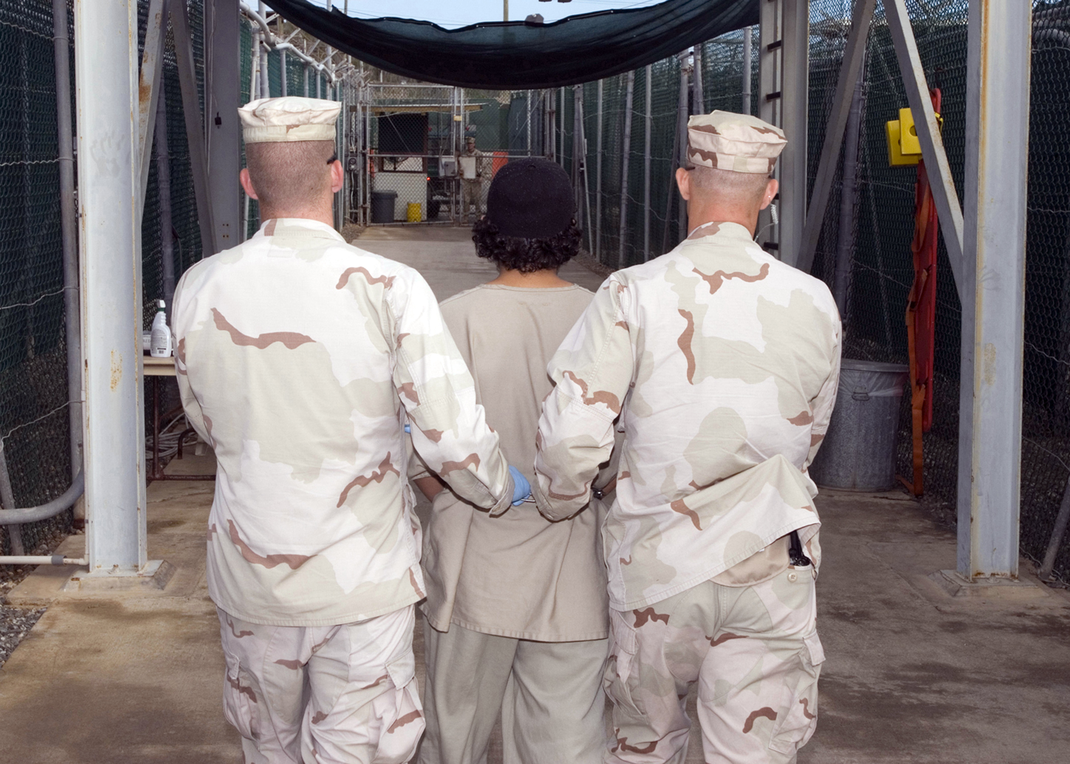 U.S. Soldiers Lead a Detainee through the Prison at Guantanamo Bay