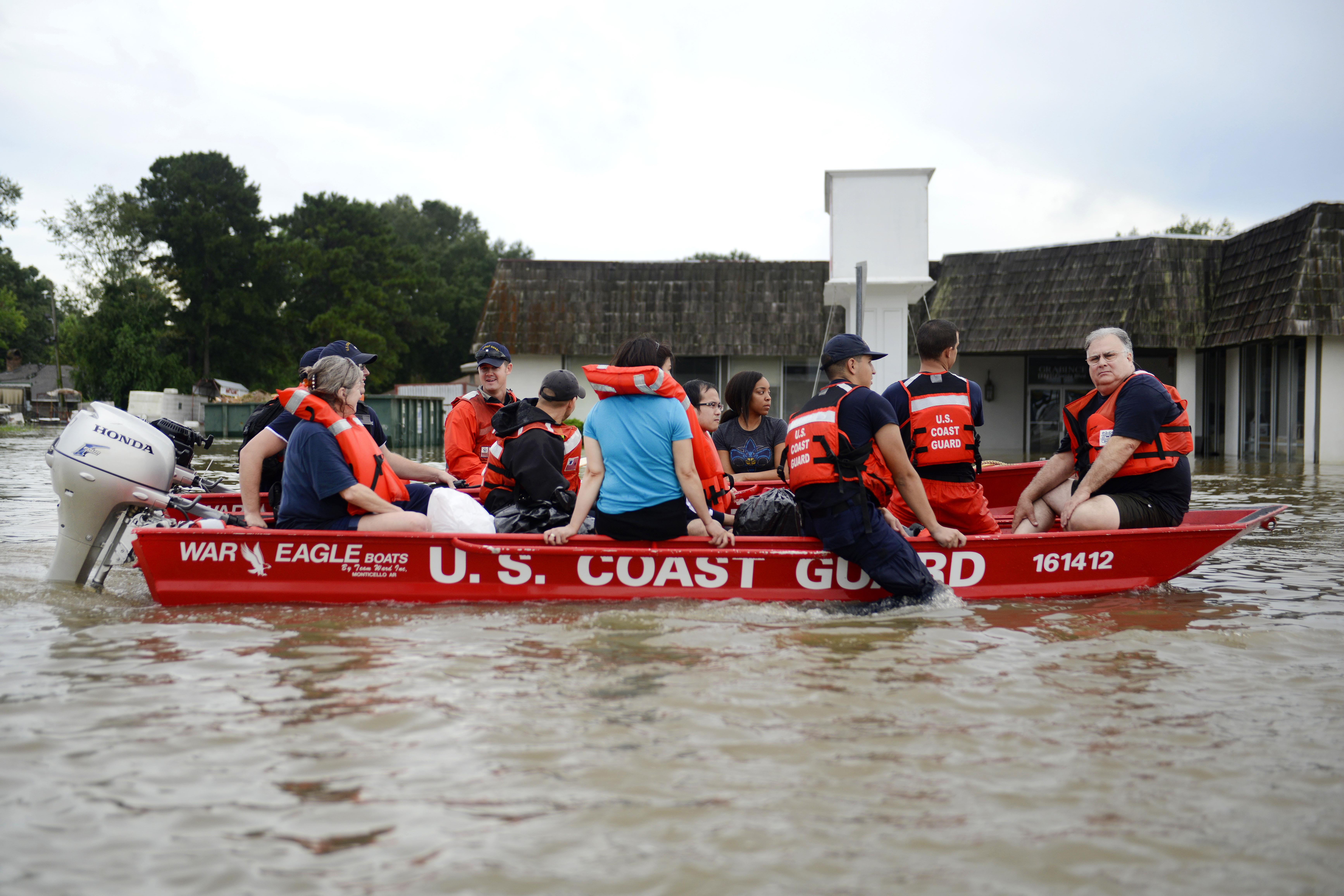 Flood victims rescued in a boat