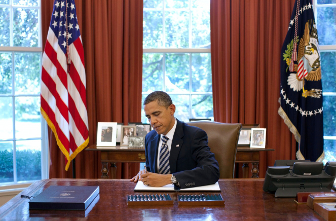 President Obama Signs a Bill