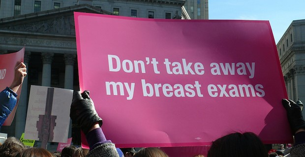 """Pink sign saying """"Don't take away my breast cancer screenings"""" at rally"""