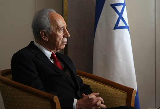 Shimon Peres, seated