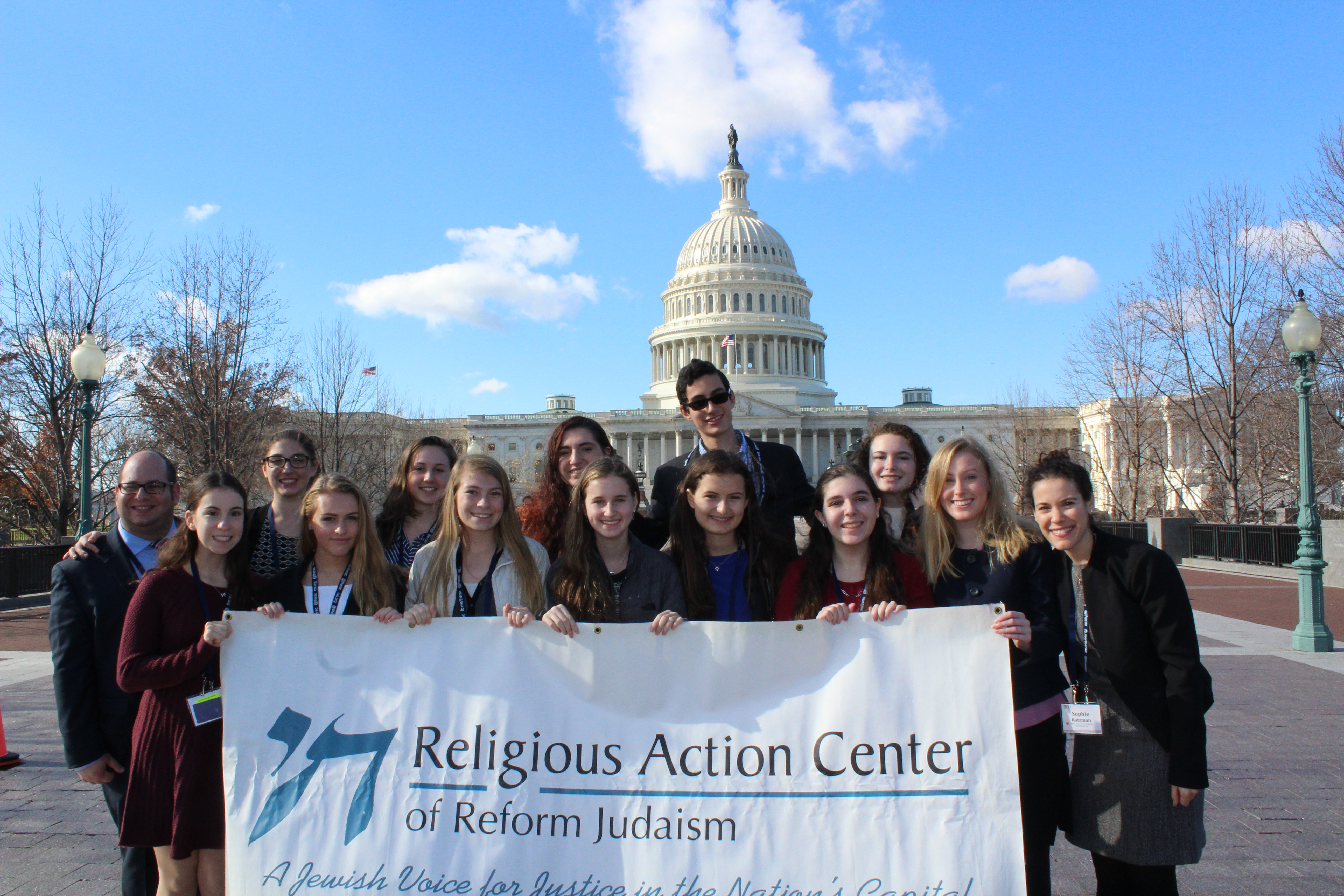 Teens standing in front of the United States Capitol building