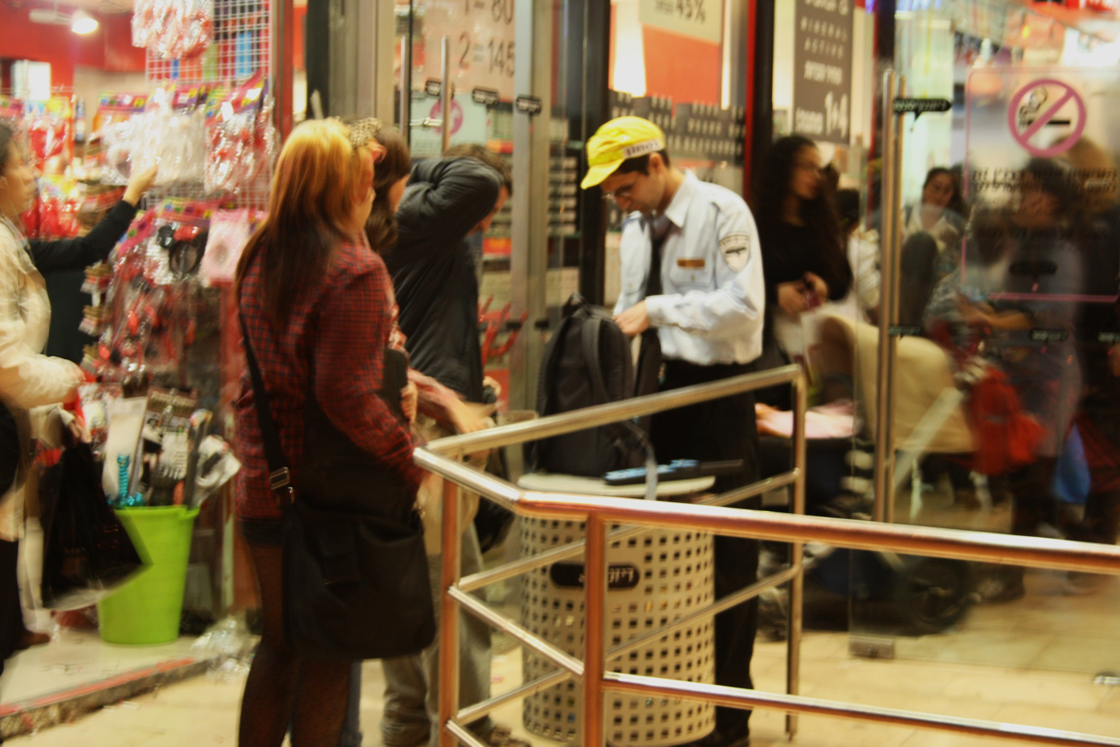 Shoppers pass through a security check at Dizengoff Center in Tel Aviv.