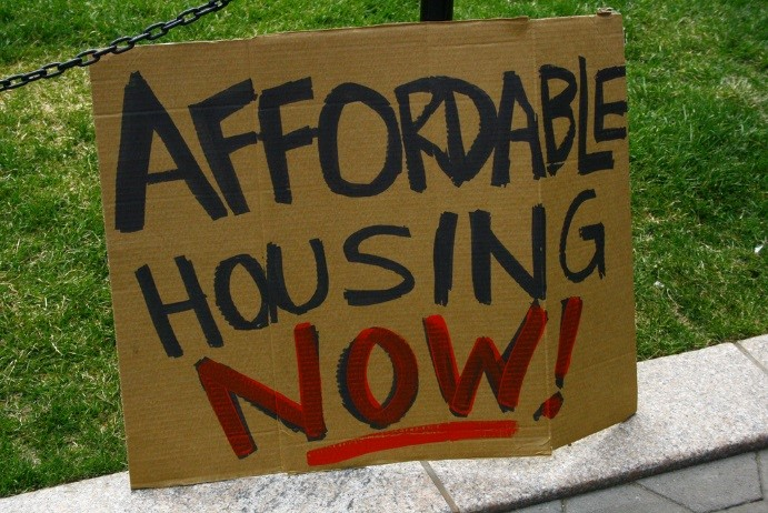 "sign reading ""Affordable Housing Now"""