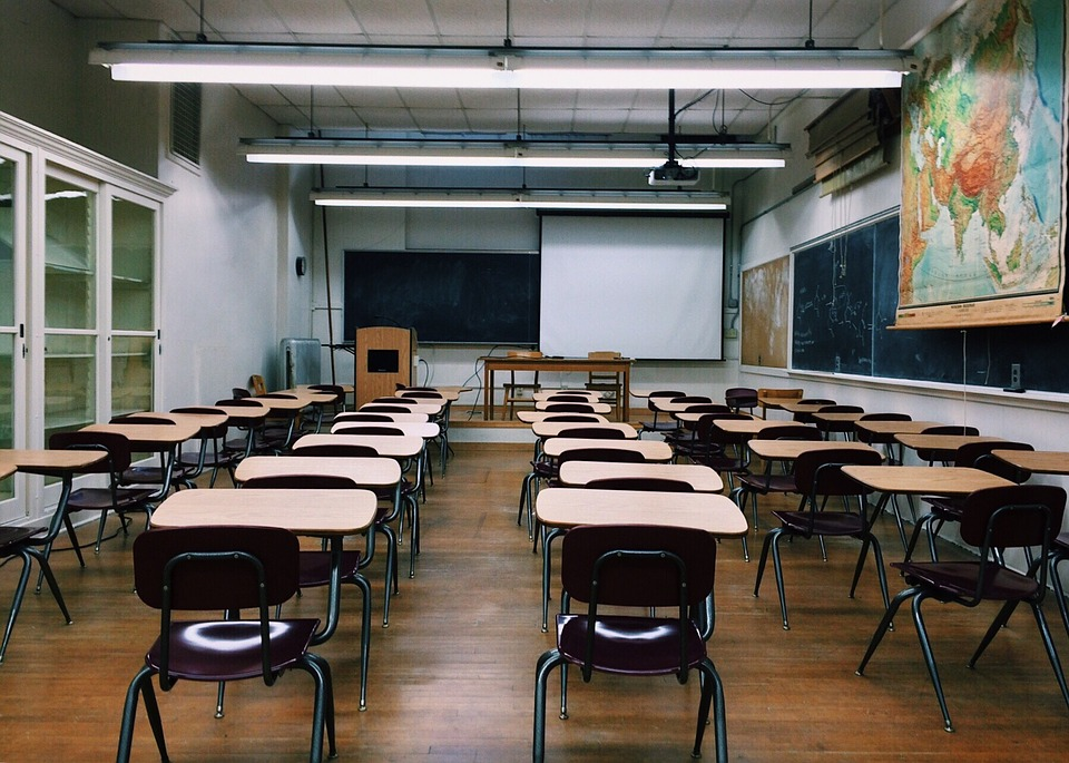 chairs in classroom with projector screen