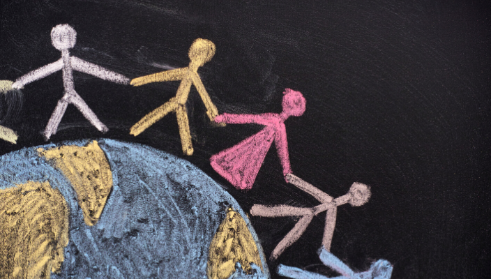 Chalk Earth with people holding hands around the globe