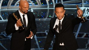 John Legend and Common accepting their Oscars