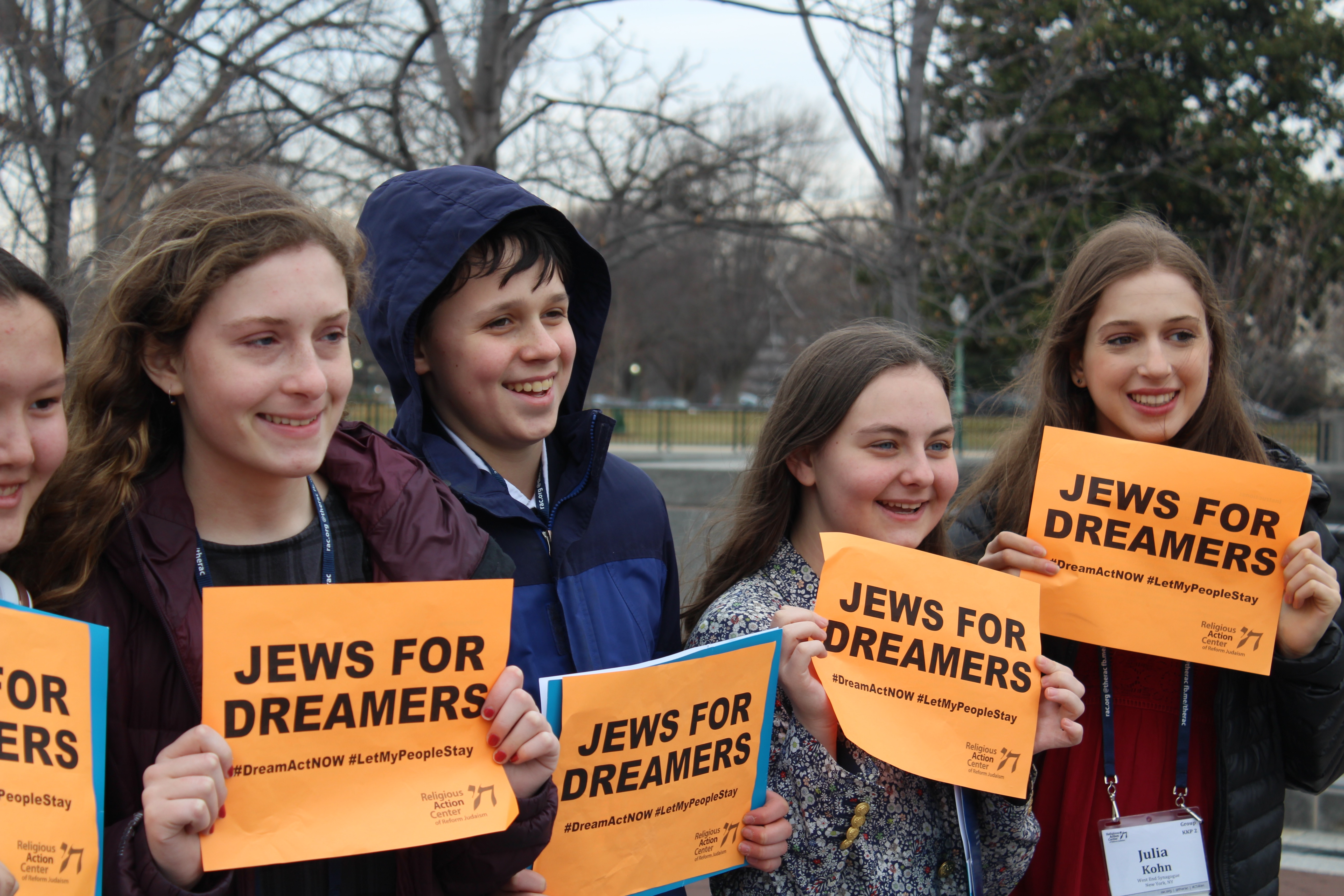 A line of high school students hold signs supporting the DREAM Act during the 2018 L'Taken seminar in Washington, D.C.