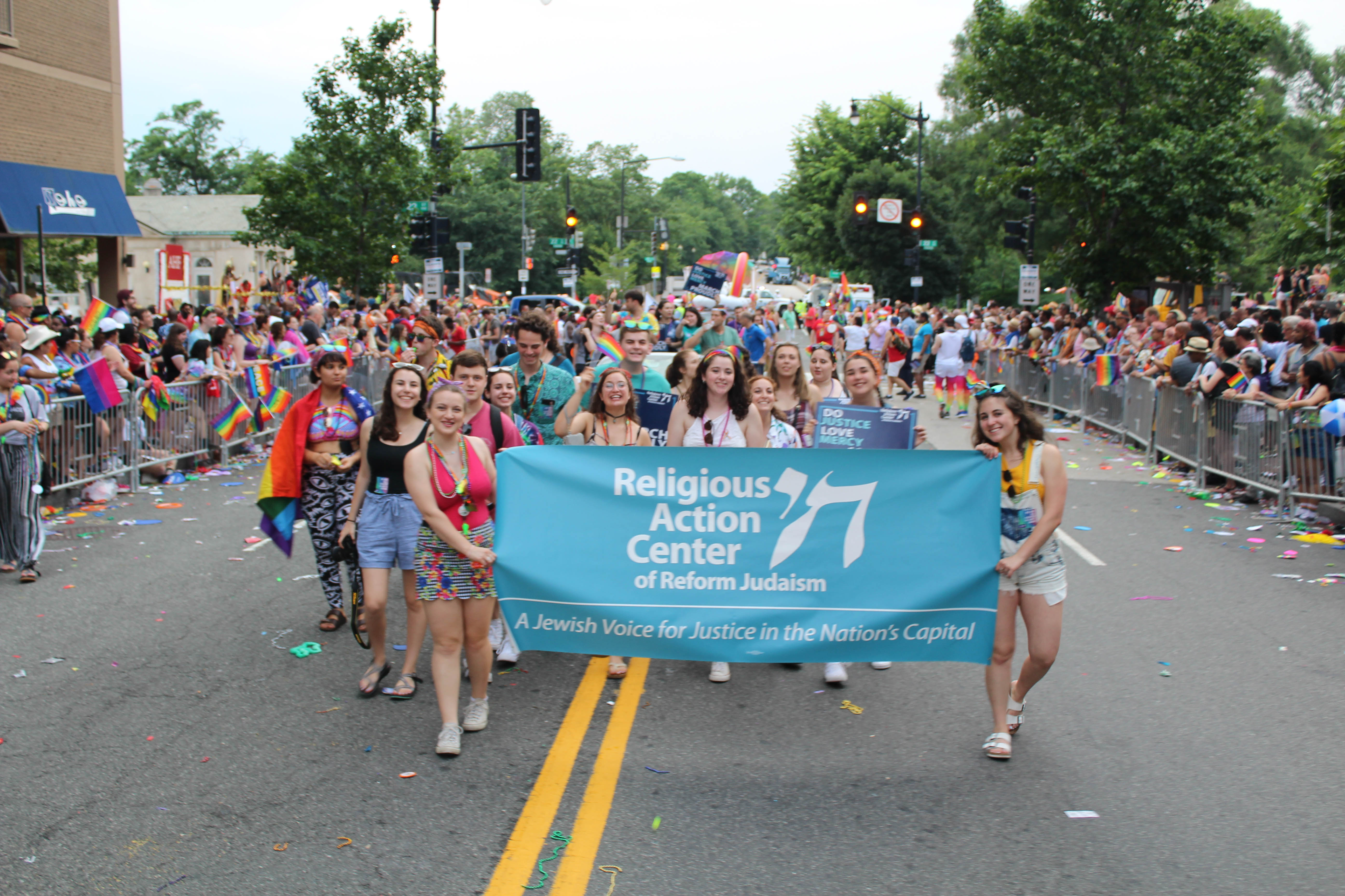 The Religious Action Center contingent marches in the 2018 Capital Pride Parade with banner