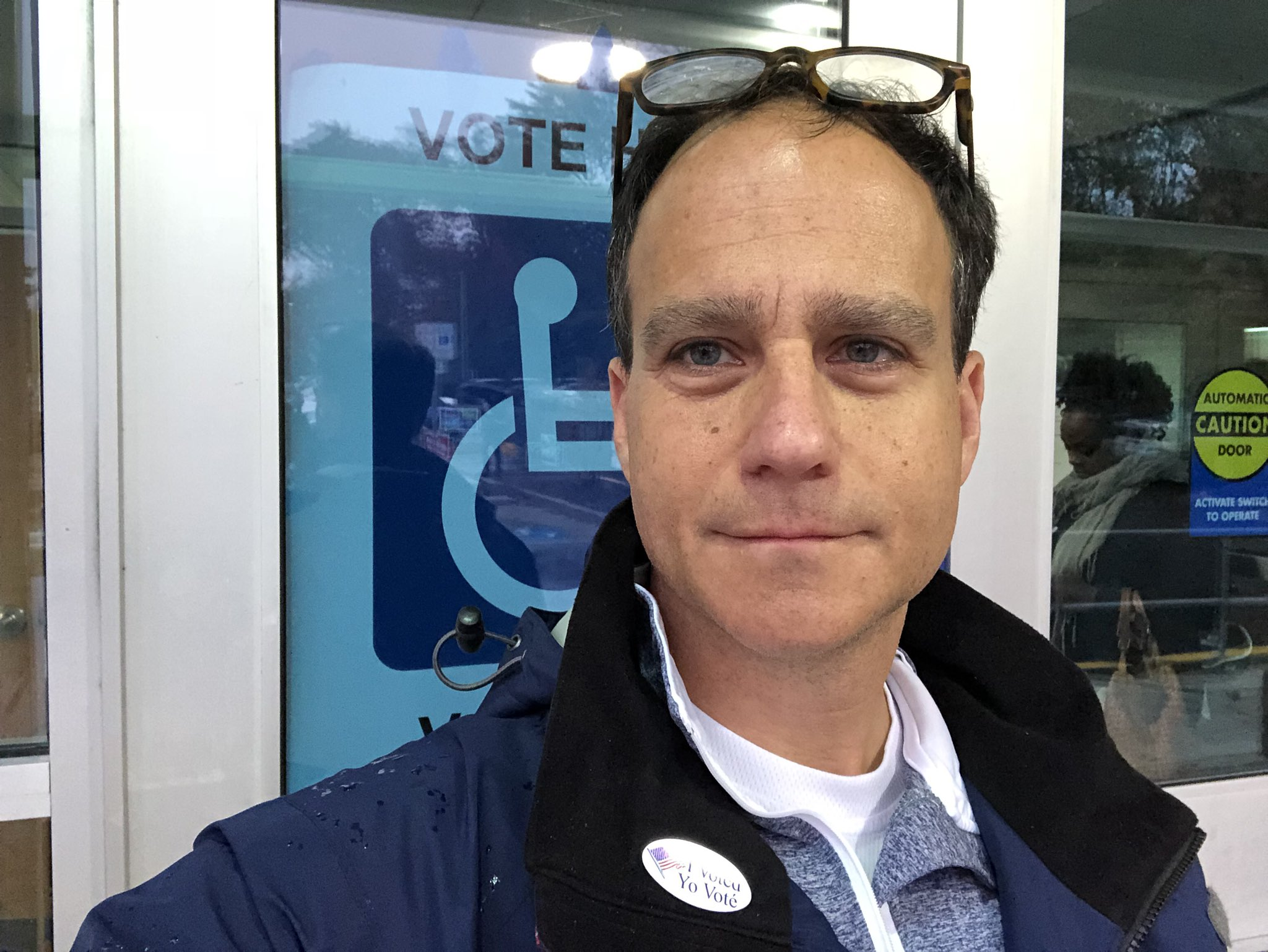 Rabbi Jonah Pesner takes a selfie outside a polling place on Election Day