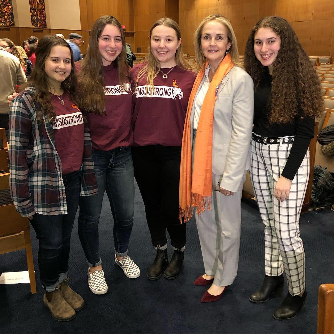 Student organizers pose with Congresswoman Madeleine Dean