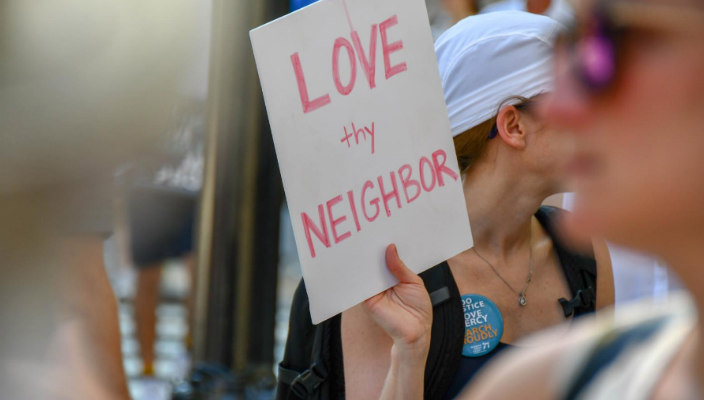 Handmade sign reading LOVE THY NEIGHBOR
