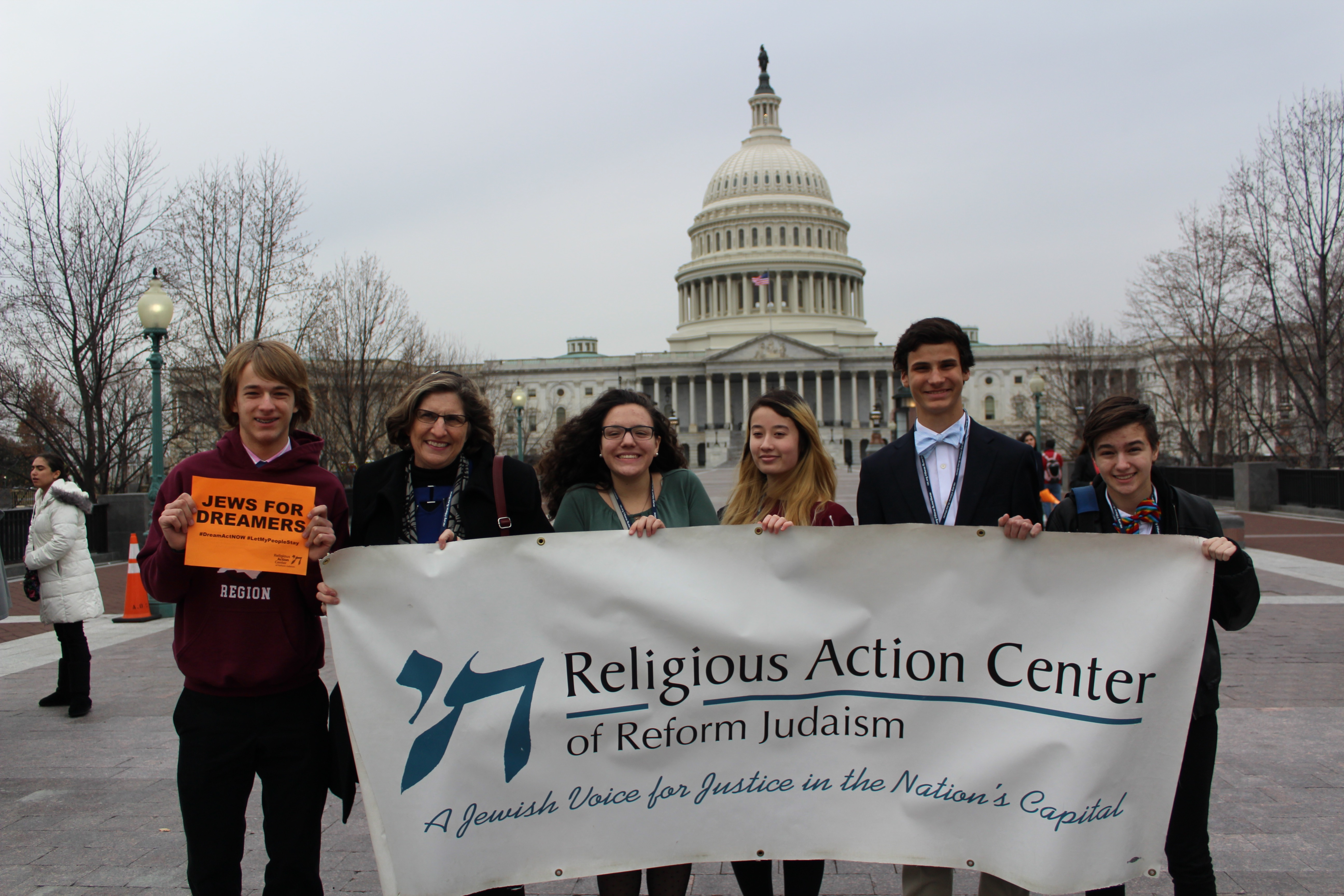 Teens and Rabbi stand in front of the US Capitol Building