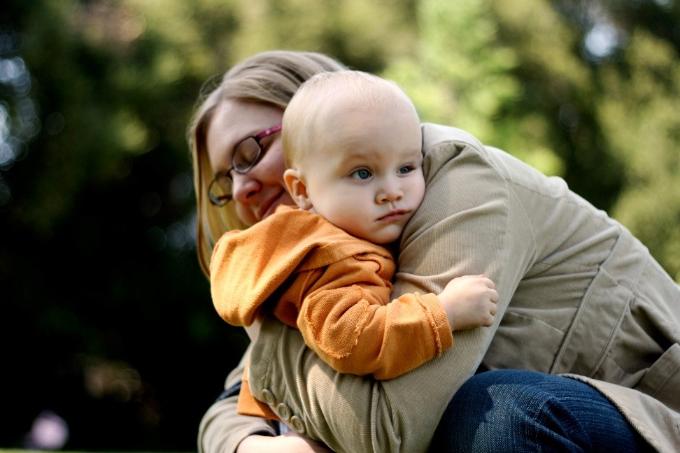 woman hugging her child