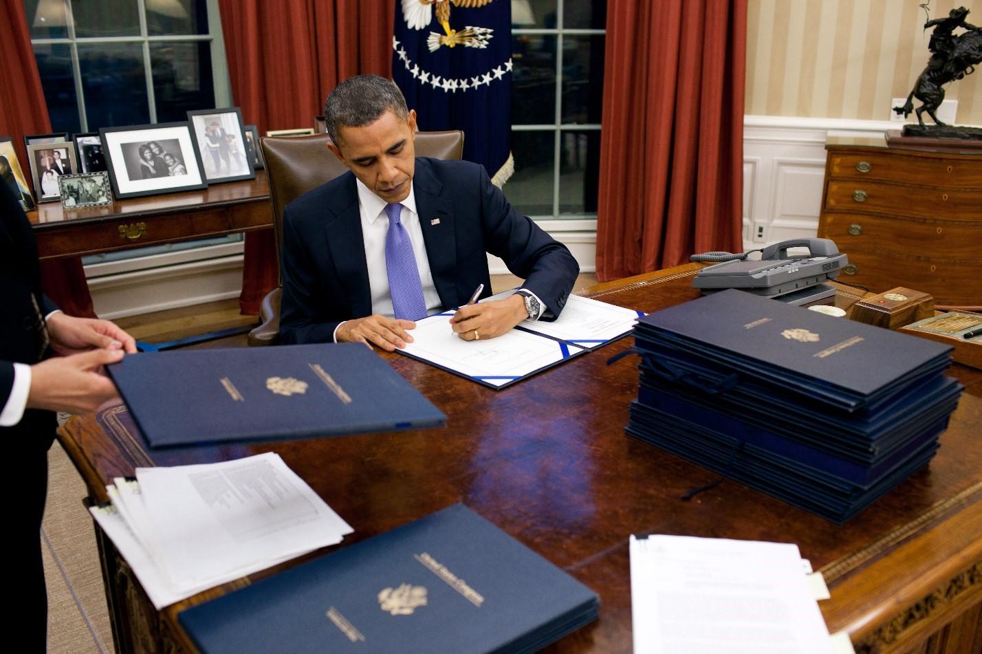 President Obama Signing Legislation.