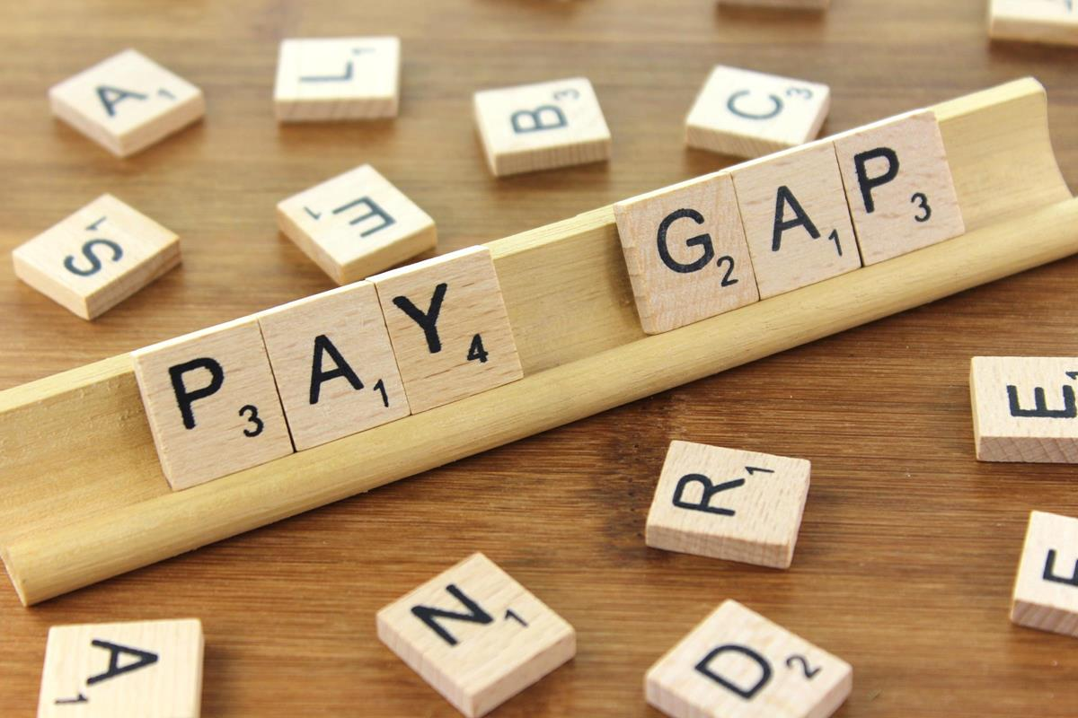 scrabble pieces spelling pay gap