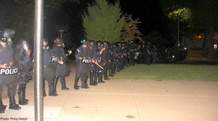 Police in riot gear outside Central Reform Congregation, St. Louis, MO