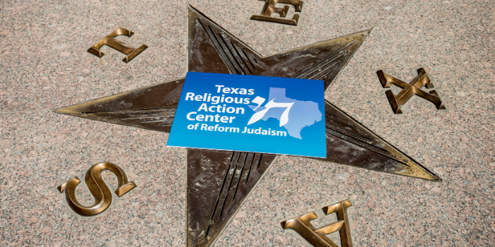 RAC-TX sign in the middle of a star