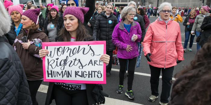 "Woman with sign that says ""Women's Rights are Human Rights"""
