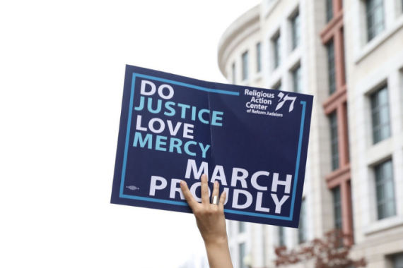 Do Justice, Love Mercy, March Proudly Sign