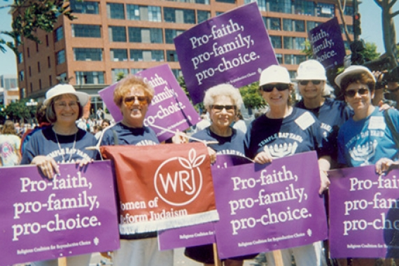 Women with signs that are pro-reproductive rights