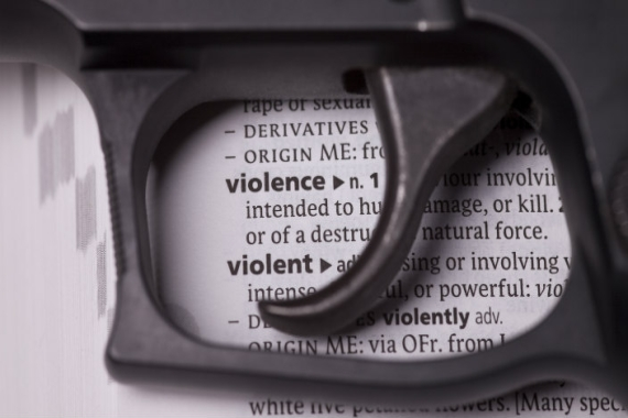 "Handgun over dictionary definition of ""violence"""