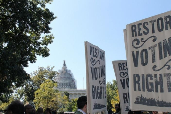 "Signs that say ""restore voting rights"""