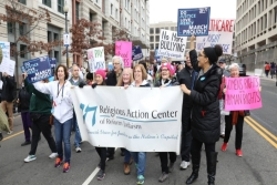 Womens March protesters carrying a sign for the Religious Action Center of Reform Judaism