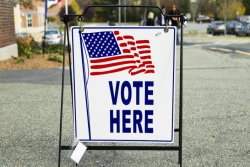 Sign outside polling place that says: Vote Here
