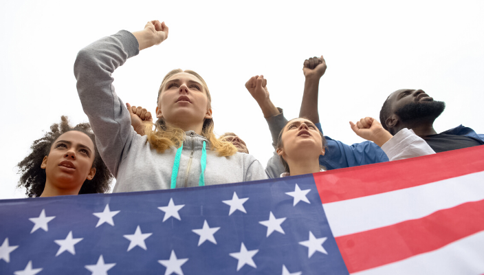 Teens holding an American flag